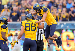 Sep 22, 2018; Morgantown, WV, USA; West Virginia Mountaineers wide receiver David Sills V (13) celebrates with teammates after catching a touchdown pass during the third quarter against the Kansas State Wildcats at Mountaineer Field at Milan Puskar Stadium. Mandatory Credit: Ben Queen-USA TODAY Sports