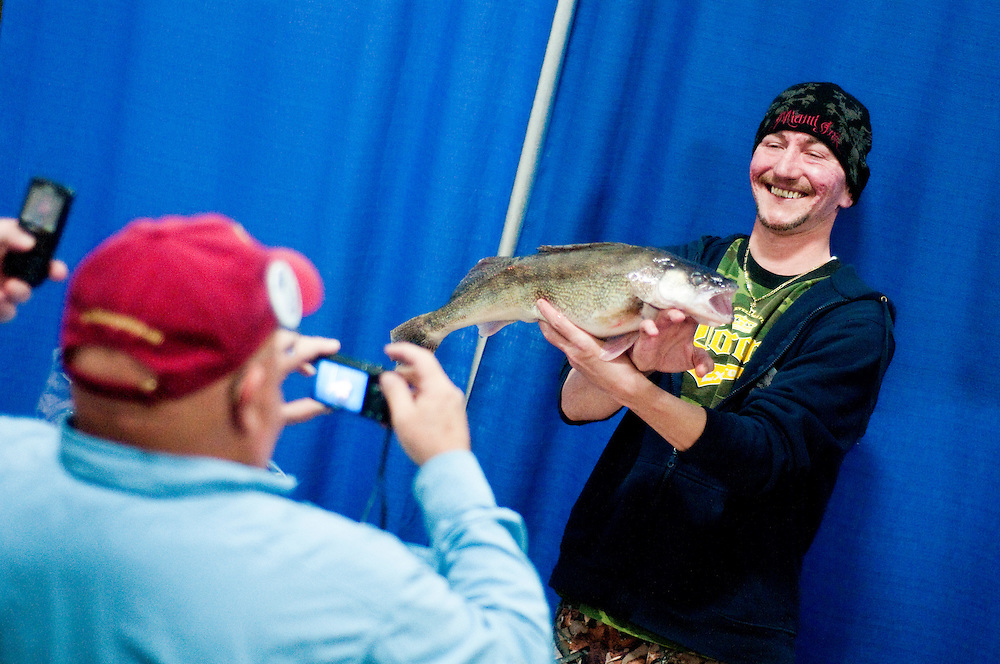 Matt Dixon   The Flint Journal..Jerry Lee Reese Jr., of Flint, holds up Saturday's winning fish in the walleye tournament during Flushing's 11th Annual Walleye Festival, Saturday, March 12.
