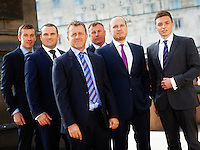 Corporate group shot taken outdoors featuring six businessman arranged in cool composition
