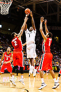 December 28th, 2013:  Colorado Buffaloes redshirt freshman forward Wesley Gordon (1) pulls up in the key for a shot over Georgia Bulldogs redshirt junior forward Marcus Thornton (2) in the second half of action in the NCAA Basketball game between the Georgia Bulldogs and the University of Colorado Buffaloes at the Coors Events Center in Boulder, Colorado