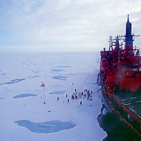 """A Nuclear-powered Russian icebreaker """"Yamal"""" unloads tourists at the North Pole."""