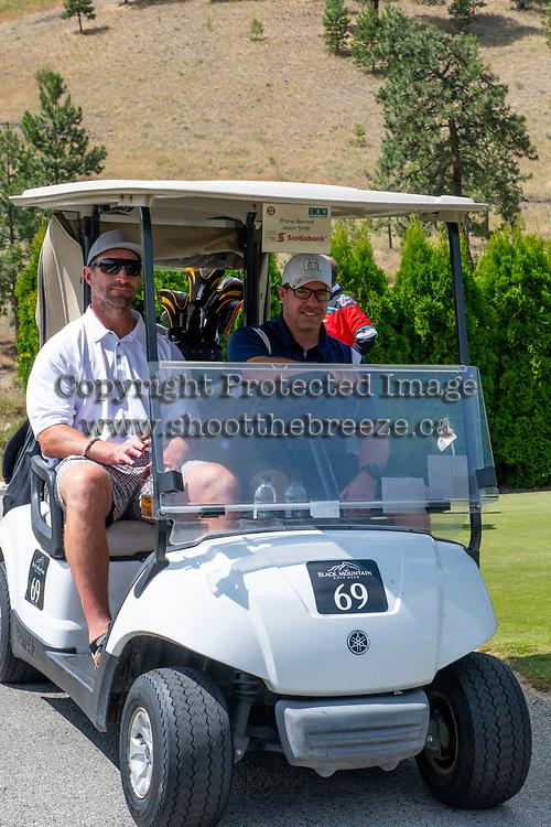 KELOWNA, CANADA - JULY 21: Jason Smith and Shane Bennett drive by at the Kelowna Rockets Alumni golf tournament at Black Mountain Golf Club in Kelowna, British Columbia, Canada.  (Photo by Marissa Baecker/Shoot the Breeze)  *** Local Caption ***