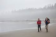 Zach Podell-Eberhardt (left) and Henry hike down a beach in the mist along the West Coast Trail, British Columbia, Canada.