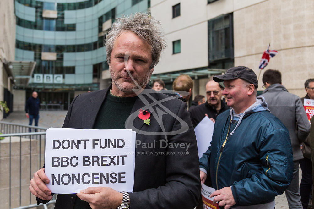 """London, November 05 2017. Several dozen protesters from the People's Charter Foundation, whose website states """"We demand for proper Brexit, and for Britain to ban Sharia law"""", demonstrate outside the BBC's New Broadcasting House before marching to Parliament Square, against what they claim is left wing, pro-remain Bias by the BBC, and against the corporations's licence fee, which they state is outdated. © Paul Davey"""