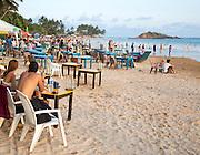People sitting at tables of beach bar, Mirissa, Sri Lanka, Asia