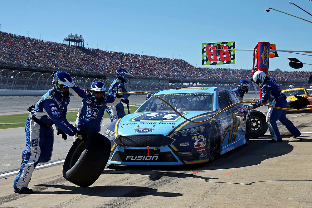 May 7, 2017; Talladega, AL, USA; NASCAR Cup Series driver Ricky Stenhouse Jr. (17) makes a pit stop during the GEICO 500 at Talladega Superspeedway. Mandatory Credit: Peter Casey-USA TODAY Sports