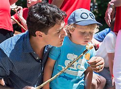 Prime Minister Justin Trudeau and his son Hadrien roast marshmallows at the Out and About Day camp at the Islands Provincial Park in Shelburne, N.S., Canada, on Friday, July 21, 2017. Photo by Andrew Vaughan/CP/ABACAPRESS.COM