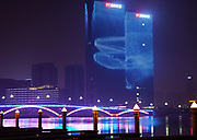 Rizhao at night, there are hi-tech 3-D holographic, video and fire displays on the beach whilst later at night several buildings have fish swimming through them. Rizhao,  Shandong province, China