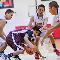 121614       Cable Hoover<br /> <br /> Ramah Mustang Skylar James (23) goes down as he tries to push past Crownpoint Eagles Nicholis Chischilly (5), Avery Jodie (12) and Tyson Charley (24) Tuesday at Crownpoint High School.