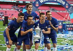 Left right right, Chelsea's Alvaro Morata, Pedro, Marcos Alonso, Cesar Azpilicueta and Davide Zappacosta celebrate with the FA Cup trophy