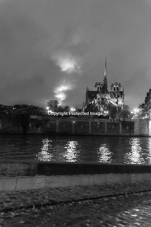 France. Paris. 4th district. Notre dame Cathedral view from The quai  d orleans along the seine river , on saint louis island, / Quai d orleans sur l ile saint Louis,