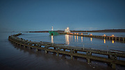 The cement freighter Arklow Raider arrives on a dawn high tide at Sharpness Docks on the River Severn