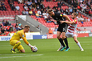Portsmouth FC defender Matthew Clarke (5) sand Doncaster Rovers forward Alfie May (19) and Portsmouth FC goalkeeper Craig MacGillivray (15) during the EFL Sky Bet League 1 match between Doncaster Rovers and Portsmouth at the Keepmoat Stadium, Doncaster, England on 25 August 2018.Photo by Ian Lyall.