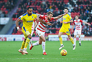 Liam Trotter of AFC Wimbledon (14) jostles with James Coppinger of Doncaster Rovers (26) during the EFL Sky Bet League 1 match between Doncaster Rovers and AFC Wimbledon at the Keepmoat Stadium, Doncaster, England on 17 November 2018.