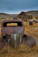 Old rusted cars in field, Bodie State Historic Park,  Mono County, California