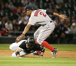 May 31, 2017 - Chicago, IL, USA - Boston Red Sox shortstop Xander Bogaerts (2) tags the Chicago White Sox's Yolmer Sanchez (5) on a run down during the fifth inning at Guaranteed Rate Field in Chicago on Wednesday, May 31, 2017. (Credit Image: © Nuccio Dinuzzo/TNS via ZUMA Wire)