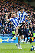 Sheffield Wednesday striker Fernando Forestieri (45) and Sheffield Wednesday defender Glenn Loovens (5) celebrate the second goal 2-0 during the Sky Bet Championship match between Sheffield Wednesday and Cardiff City at Hillsborough, Sheffield, England on 30 April 2016. Photo by Ellie Hoad.