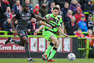 Forest Green Rovers Paul Digby(20) passes the ball forward during the EFL Sky Bet League 2 match between Forest Green Rovers and Lincoln City at the New Lawn, Forest Green, United Kingdom on 2 March 2019.