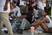 Shawn Stinchcomb sits in an intersection during a protest at Craig Ranch North in response to an incident with teens and police officers at a community pool in McKinney, Texas on June 8, 2015.  (Cooper Neill for The New York Times)