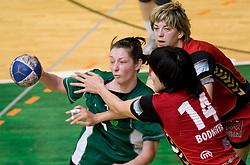 Nina Jericek of Olimpija vs Ljudmila Bodnieva and Maryna Vergeljuk of Krim at handball Slovenian cup Finals match  between RK Olimpija and RK Krim Mercator, on March 28, 2010, SD Leon Stukelj, Novo mesto, Slovenia. (Photo by Vid Ponikvar / Sportida)