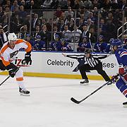 Adam Hall, (left), Philadelphia, Flyers, shoots during the New York Rangers Vs Philadelphia Flyers, NHL regular season game at Madison Square Garden, New York, USA. 26th March 2014. Photo Tim Clayton