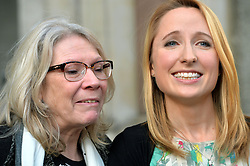 Widow Beth Warren (right),with her mother-in-law Helen Brewer (left),  leave The High Court, London, UK, after winning her fight with the High Court to preserve her late husband's sperm.<br /> Thursday, 6th March 2014. Picture by Ben Stevens / i-Images