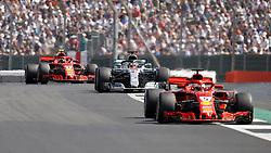 Ferrari's Sebastian Vettel (right), Mercedes' Lewis Hamilton and Ferrari's Kimi Raikkonen during the 2018 British Grand Prix at Silverstone Circuit, Towcester.