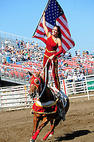 A Sureshot Productions trick rider finishes up their program with a patriotic theme at the 102nd California Rodeo Salinas, which opened July 19 for a four-day run.