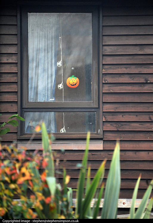 ©London News pictures...16/11/2010. A childs you hangs in the upstairs window of the house. A 44-year-old man has been arrested on suspicion of murder today (Tues) after a woman's body was found at a property in Bracknell in Berkshire. Officers visited the home in Inchwood in Birch Hill on Monday afternoon after a phone call from the victim's family, raising concern for her welfare. Stephen Simpson/London News Pictures.