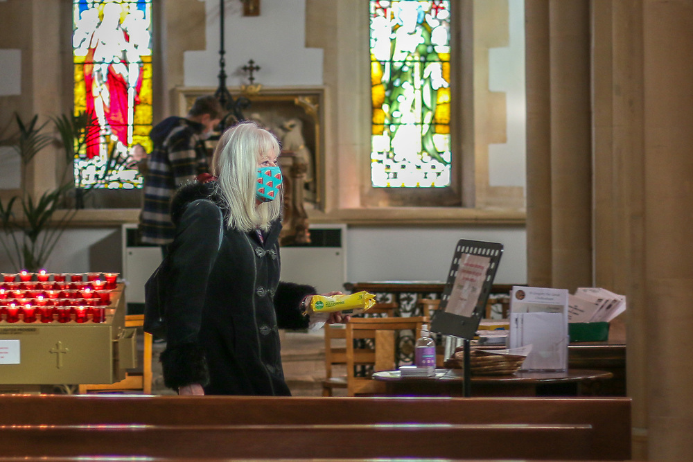 28th February, Cheltenham, England. A member of St Gregory's Catholic Church in Cheltenham carries a packet of anti-bacterial wipes during the third national lockdown.