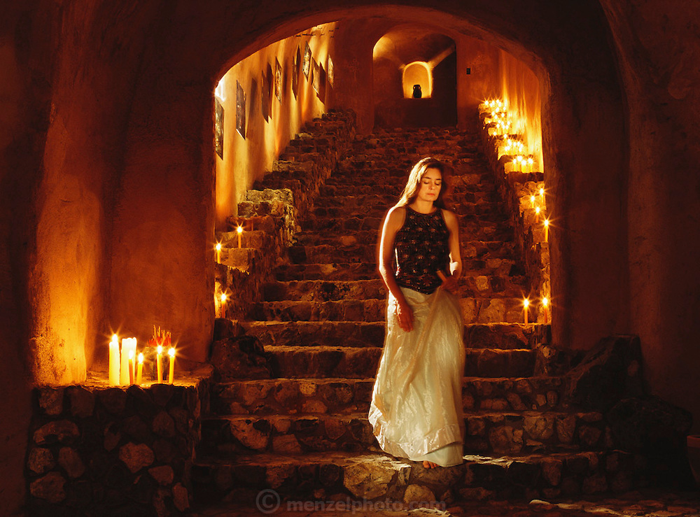Faith D'Aluisio descending the stairs of the Menzel D'Aluisio cave in Napa Valley, California. MODEL RELEASED.