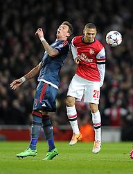 Arsenal's Kieran Gibbs battles for the high ball with Bayern Munich's Mario Mandzukic - Photo mandatory by-line: Joe Meredith/JMP - Tel: Mobile: 07966 386802 19/02/2014 - SPORT - FOOTBALL - London - Emirates Stadium - Arsenal v Bayern Munich - Champions League - Last 16 - First Leg