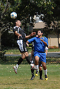 Luis Fletes (#3) of Deportivo Colomex heads the ball while competing with Team Shlama F.C. during National Soccer League play in Skokie, Il.