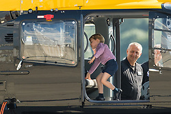 Prince George in a rescue helicopter during a visit to Airbus in Hamburg, Germany with his parents the Duke and Duchess of Cambridge and sister Princess Charlotte.