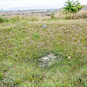 A grassed over bomb crater from the Vietnam War. During the period 1964 through 1973, the Plain of Jars region was bombed heavily by the US Air Force in an effort to disrupt the supply lines of the Ho Chi Minh Trail.