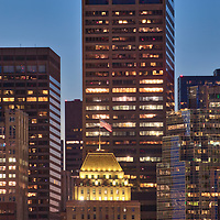 Boston night photography featuring iconic skyscrapers surrounding 160 Federal Street on a beautiful evening at twilight. Boston skyline photography images are available as museum quality photography prints, canvas prints, acrylic prints or metal prints. Fine art prints may be framed and matted to the individual liking and decorating needs:<br />