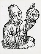 'Johannes Muller von Konigsberg (1436-1476) best known today as Regiomontanus, German mathematician, astronomer, and translator, shown holding an astrolabe. Woodcut, 1493.'