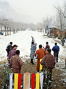 Archers gather for a day-off for the first snow fall of the year. Archery is Bhutan's national sport.