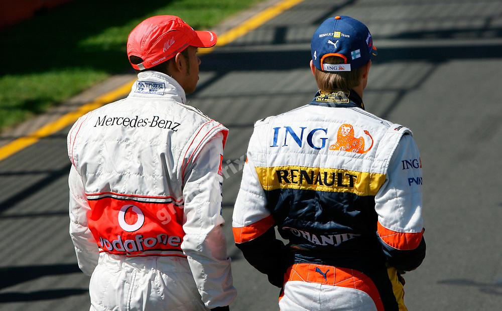 Lewis Hamilton (McLaren-Mercedes) and Heikki Kovalainen (Renault) before the 2007 Australian Grand Prix in Melbourne. Photo: Grand Prix Photo