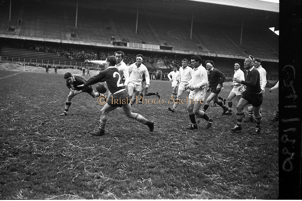 19/01/1963<br /> 01/19/1963<br /> 19 January 1963<br /> International Rugby Trials at Lansdowne Road, Dublin. Wall (left) and Butler try to intercept Kelly's (White) kick to tpuch.