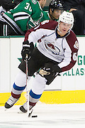 DALLAS, TX - SEPTEMBER 26:  Andre Benoit #61 of the Colorado Avalanche controls the puck against the Dallas Stars in an NHL preseason game on September 26, 2013 at the American Airlines Center in Dallas, Texas.  (Photo by Cooper Neill/Getty Images) *** Local Caption *** Andre Benoit