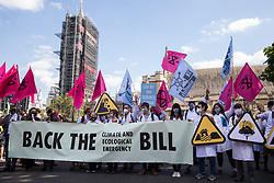 Climate activist scientists from Extinction Rebellion hold a banner calling for support for the Climate and Ecological Emergency Bill (CEE Bill) during a Back The Bill rally in Parliament Square on 1st September 2020 in London, United Kingdom. Extinction Rebellion activists are attending a series of September Rebellion protests around the UK to call on politicians to back the CEE Bill which requires, among other measures, a serious plan to deal with the UK's share of emissions and to halt critical rises in global temperatures and for ordinary people to be involved in future environmental planning by means of a Citizens' Assembly.