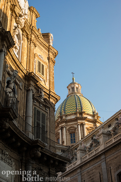 The Church of Catherine of Alexandria is seen in the setting sun from the Quatro Canti square in the heart of Palermo, Sicily.