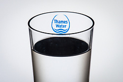 "File photo dated 02/08/16 of the logo of water company Thames Water seen through a glass of water as profits in Britain's biggest water company have crashed 86\% after a year of ""challenges"" which saw it miss leak targets for the first time in 11 years and face a record fine for sewage pollution."