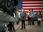 """31 OCTOBER 2019 - DES MOINES, IOWA: Iowa State Senator CLAIRE CELSI speaks in support of the Affordable Care Act. A small crowd of people came to the Neil Smith Federal Building, where US Senators Chuck Grassley's (R-IA) and Joni Ernst's (R-IA) offices are, to deliver a petition protesting the Senate's vote that critics say would allow """"spooky junk health insurance plans"""" with limited coverage and would allow insurance companies to deny coverage to people with pre-existing conditions.           PHOTO BY JACK KURTZ"""