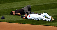 MORNING JOURNAL/DAVID RICHARD<br />Cleveland second baseman Ronnie Belliard and umpire Eric Cooper both lay on the ground after they collided while Belliard was chasing down a ground ball yesterday at Jacobs Field. Belliard left the game with a neck injury.