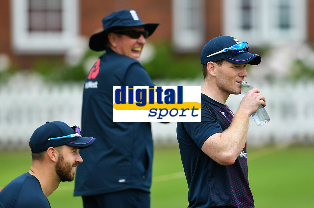 Cricket - 2019 ICC Cricket World Cup - pre-Final practice & press conferences<br /> <br /> England's Eoin Morgan in good spirits as Coach Trevor Bayliss laughs in the background, at Lords.<br /> <br /> COLORSPORT/ASHLEY WESTERN