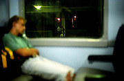 Sleeping person in the train from the Czech capital Prague to the city of Lysa nad Labem.