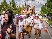 31 OCTOBER 2012 - YALA, YALA, THAILAND: Villagers from Wat Kohwai pull a float from their village while they process through Yala for Ok Phansa. Ok Phansa marks the end of the Buddhist 'Lent' and falls on the full moon of the eleventh lunar month (October). It's a day of joyful celebration and merit-making. For the members of Wat Kohwai, in Yarang District of Pattani, it was a even more special because it was the first time in eight years they've been able to celebrate Ok Phansa. The Buddhist community is surrounded by Muslim villages and it's been too dangerous to hold the boisterous celebration because of the Muslim insurgency that is very active in this area. This the year the Thai army sent a special group of soldiers to secure the village and accompany the villagers on their procession to Yala, a city  about 20 miles away.   PHOTO BY JACK KURTZ