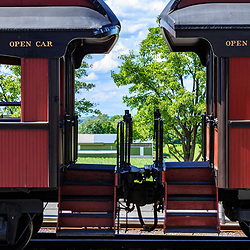 Strasburg, PA / USA - June 27, 2017:  Coupled red passenger cars at the Strasburg Rail Road station in rural Lancaster County, Pennsylvania.
